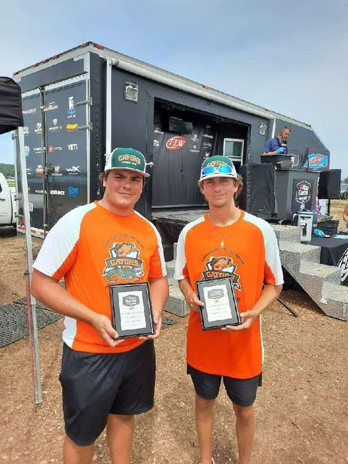 Grady Doucet and Trent Buchholz pose following Friday's third-place finish in Oklahoma.