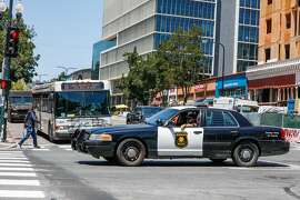 A Berkeley Police car drives on University Avenue on Wednesday, July 8, 2020 in Berkeley, California.