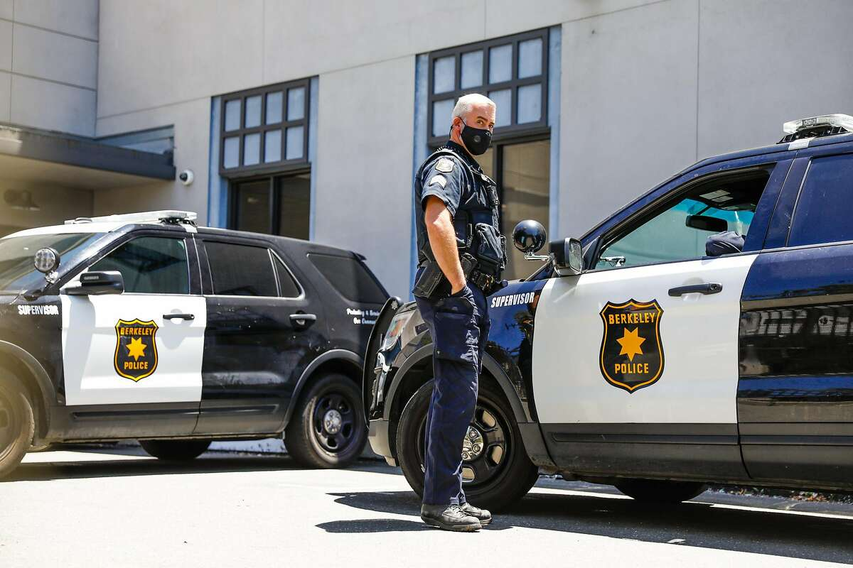Police officers chat in the parking lot at the Berkeley Police Department on Wednesday, July 8, 2020.