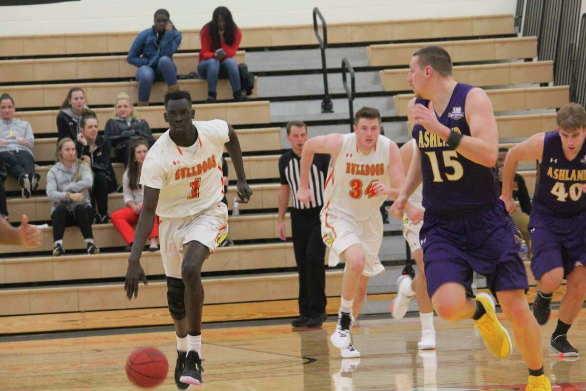Ferris' Deng Reng (1) takes the ball down the court during last season's action. (Pioneer file photo)