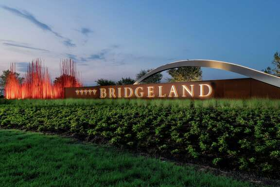 The majestic entrance into Bridgeland includes beautiful public art.