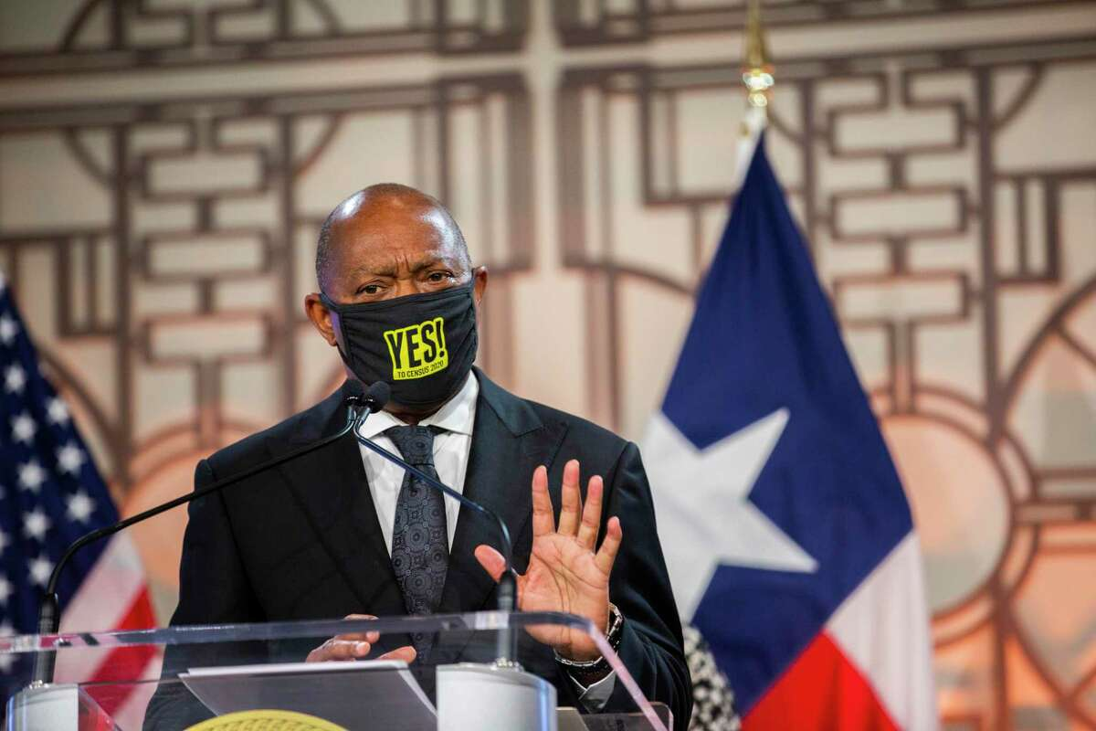 Houston Mayor Sylvester Turner, pictured at City Hall Thursday, July 9, 2020, has asked Houston's postmaster to explain why officials at more than a dozen of the city's 86 post offices have declined to accept and display multilingual voter registration materials.