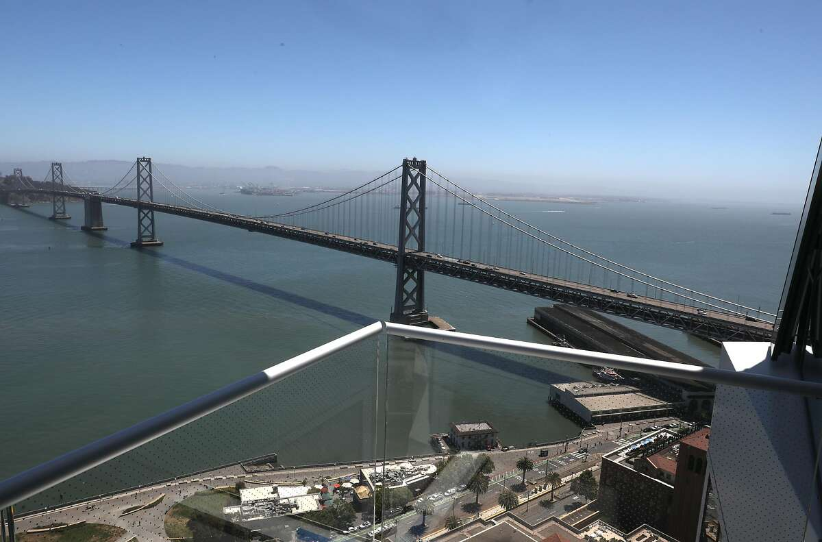 View of the bridge seen from a patio deck at Jeannie Gang's tower Mira on Tuesday, June 30, 2020, in San Francisco, Calif.