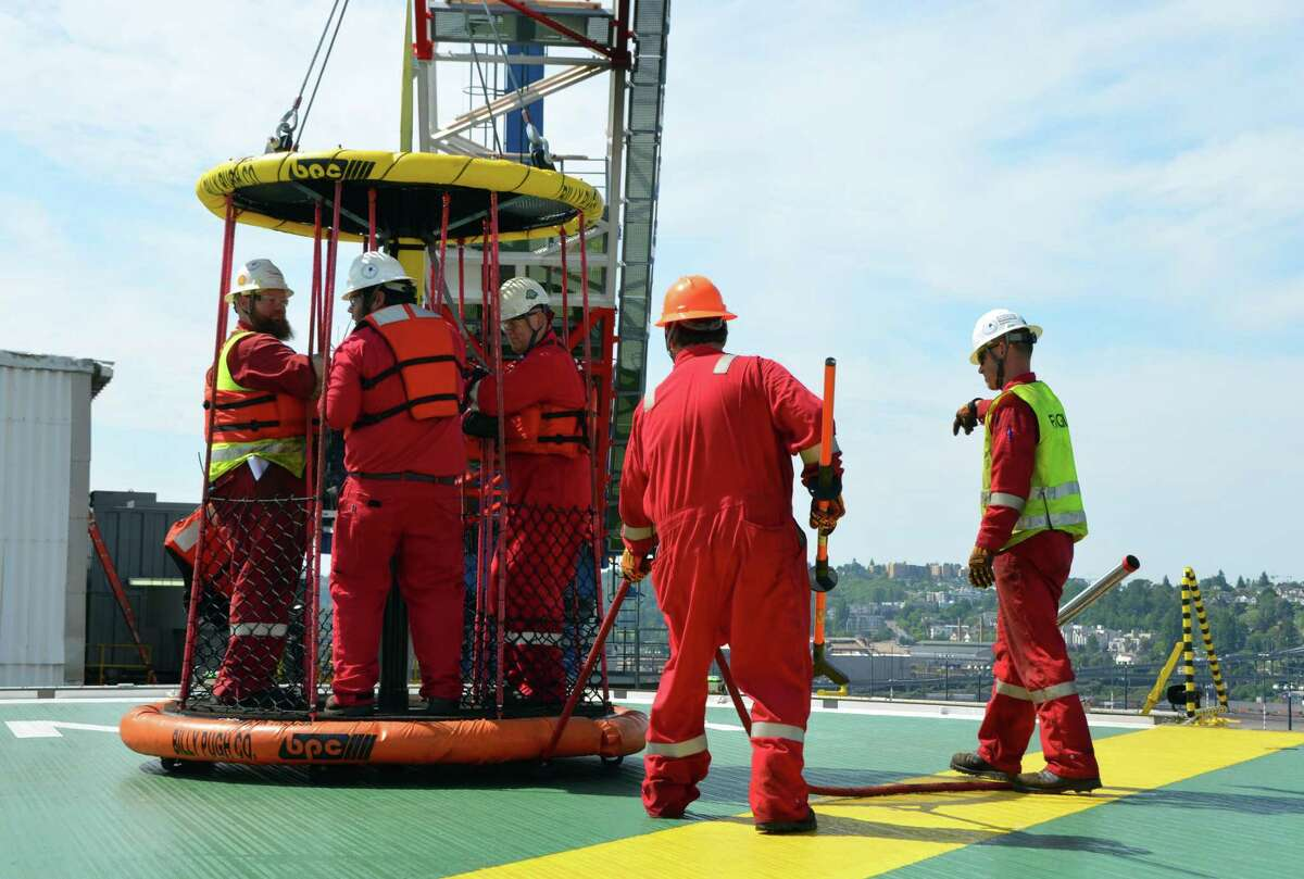 Workers aboard a Transocean rig are shown. More than 100 company workers could be out of a job because one of Transocean's rigs failed to land a new contract.