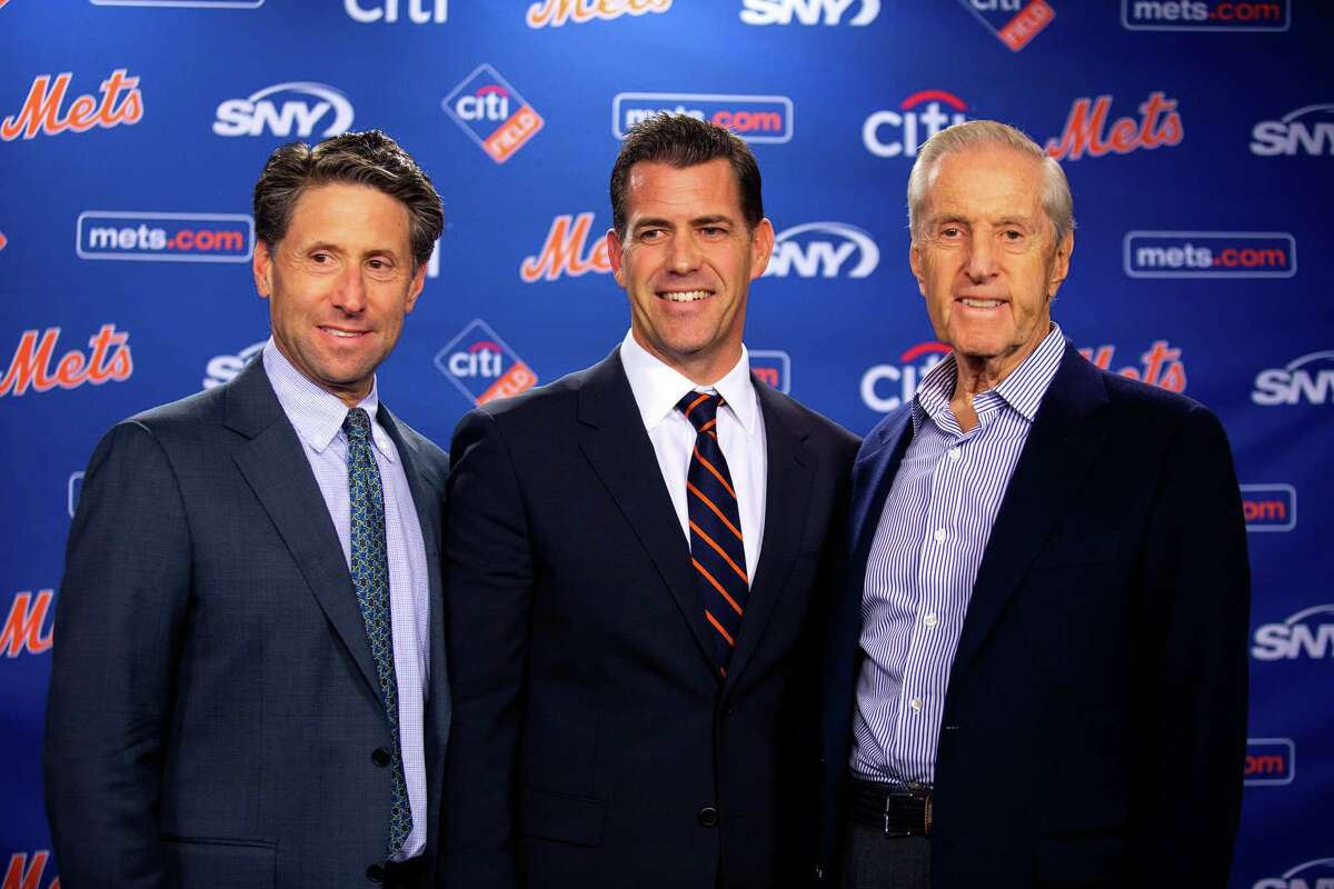 Jeff Wilpon, left, and majority owner Fred Wilpon, right, introduce Brodie Van Wagenen as the New York Metsa€™ general manager, at Citi Field in Queens, Oct. 30, 2018. Van Wagenen is a prominent agent with no experience as a team executive, but has represented at least four Mets players. (Demetrius Freeman/The New York Times)