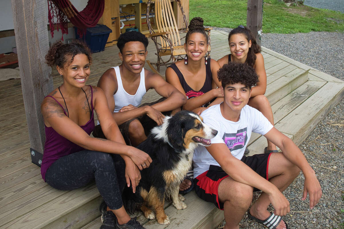 Brooke Bridges, left, a farm hand at Soul Fire Farm, Kweku Wooten, second from right, an apprentice at the farm, Leah Penniman, third from left, co-founder and co-director of the farm, and her two children, Emet Vitale-Penniman, and Neshima Vitale-Penniman, pose for a photo at the farm on Thursday, July 9, 2020, in Petersburgh, N.Y. (Paul Buckowski/Times Union)