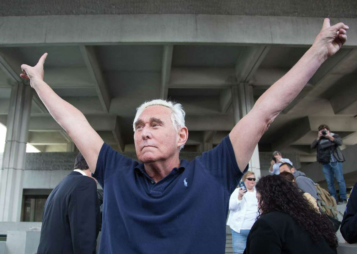 (FILES) In this file photo taken on January 25, 2019 Roger Stone, a longtime adviser to US President Donald Trump, throws up peace signs outside court in Fort Lauderdale, Florida. - US President Donald Trump communted the 40-month prison sentence of longtime ally Roger Stone on July 10, 2020, the White House said. (Photo by Joshua Prezant / AFP) (Photo by JOSHUA PREZANT/AFP via Getty Images)