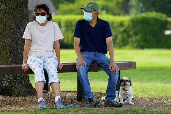 Nothing exceptional here. Just two Texans doing the right thing by wearing masks at a park in Richardson. No freedom infringed.  A reader thinks Texans should be proud of masking up and doing the right thing.