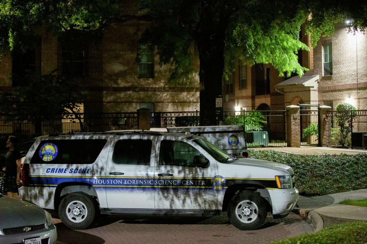 A vehicle from the Houston Forensic Science Center is park near the area in Camden Greenway Apartments where two adult females were found deceased at the scene on Friday, July 10, 2020, in Houston.