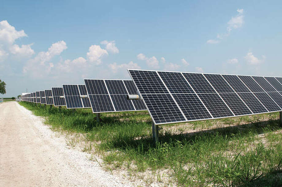 There are four solar panel farms in Morgan County. Summit Ridge Energy has incentives for residents and businesses to use solar power. One of the four farms, south of Woodson, is helping reduce carbon released into the atmosphere by using clean energy. Photo: Darren Iozia   Journal-Courier