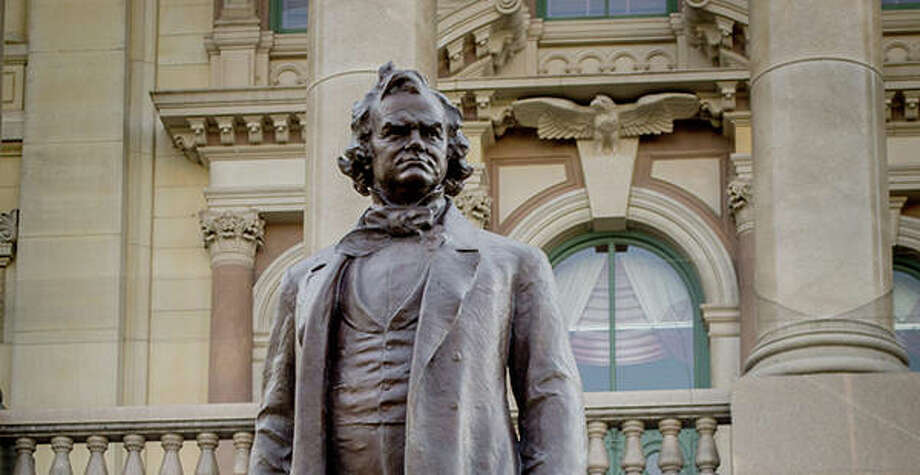 A statue of Stephen Douglas sits behind one of his political rival Abraham Lincoln at the Illinois Statehouse. House Speaker Michael Madigan has called for a removal of Douglas' image from the Capitol grounds. Photo: Jerry Nowicki | Capitol News Illinois