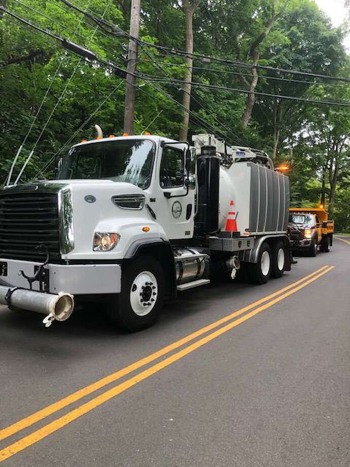 The Town of Darien planned for some stormy weather Friday by cleaning out storm drains in the hope of alleviating any flooding due to heavy rainfall. Photo: Nina Miller