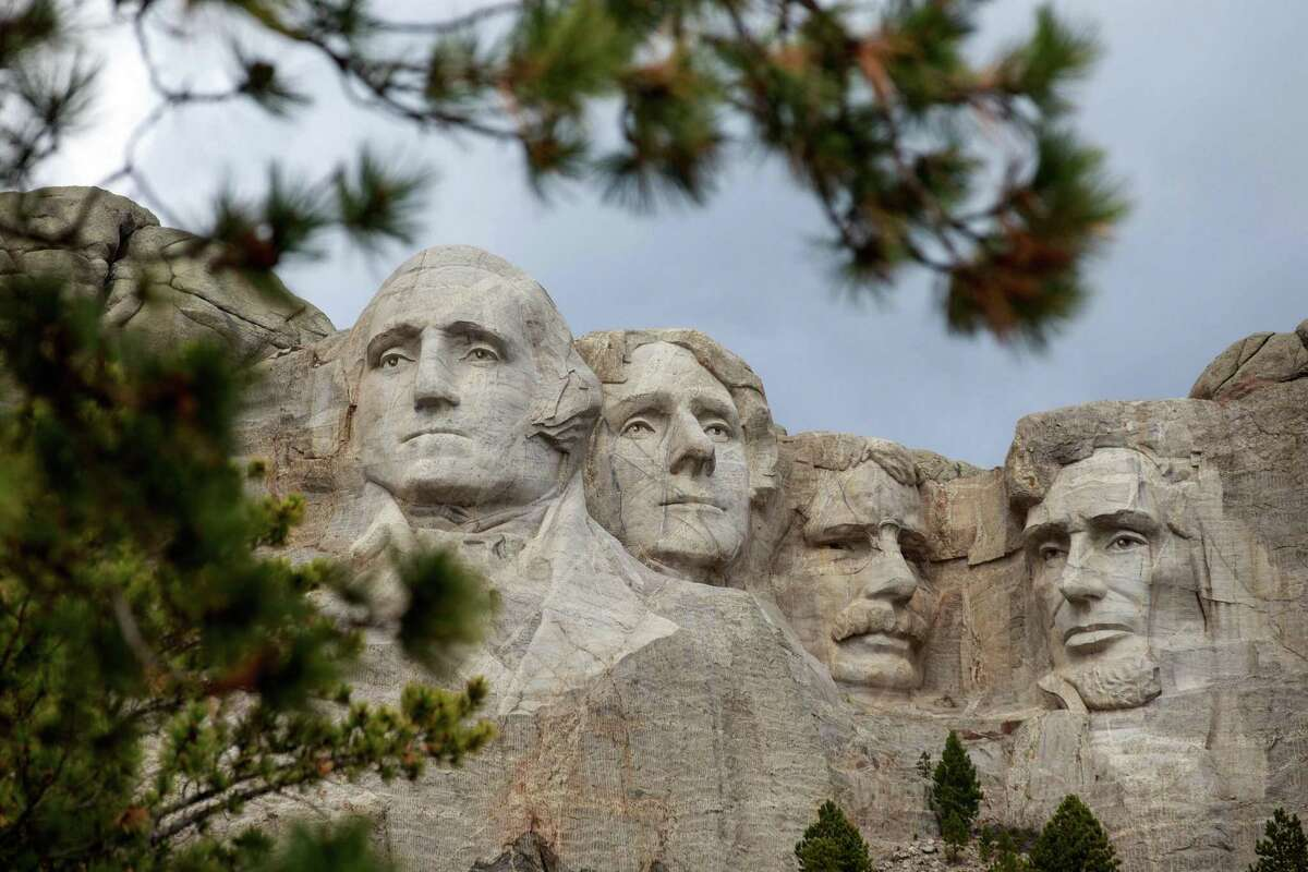 (FILES) In this file photo taken on April 23, 2020 Mount Rushmore National Memorial on April 23, 2020, in Keystone, South Dakota. - Under fire for his silence in the face of America's spiralling coronavirus caseload, President Donald Trump heads to Mount Rushmore on July 3, 2020 for a night of fireworks that he hopes will soothe a nation he has struggled to unite. On the eve of the country's Independence Day, the Republican leader will speak in the shadow of four of his notable predecessors: George Washington, Thomas Jefferson, Theodore Roosevelt and Abraham Lincoln, whose heads are carved into the granite in South Dakota. (Photo by Kerem Yucel / AFP) (Photo by KEREM YUCEL/AFP via Getty Images)