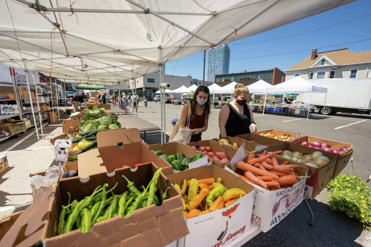 Customers shop at the Spring Street Farmers Market in Stamford. The market is open Saturdays from 9 a.m. to 2 p.m.