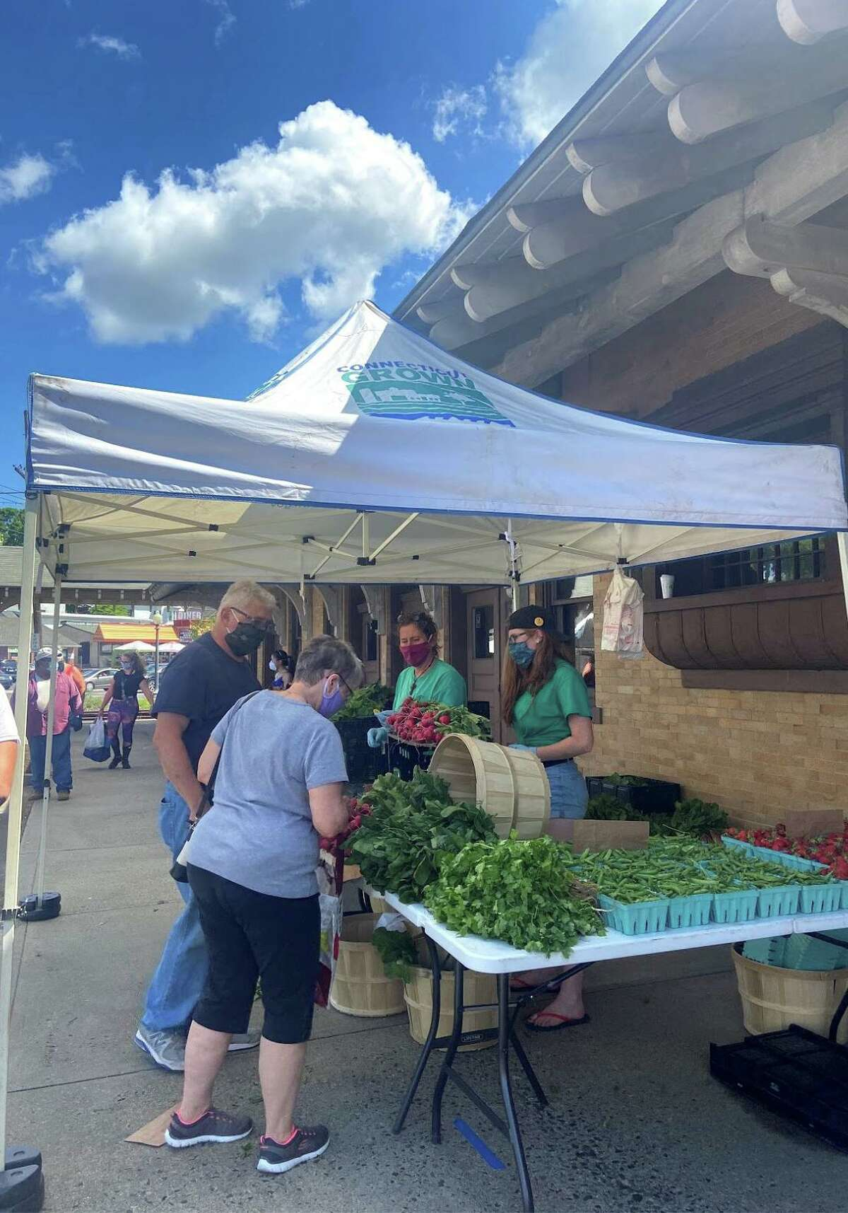 Customers buy produce at the Danbury Farmers Market. Located outside the Danbury Railway Museum, it's open Fridays from 10 a.m. to 2 p.m.