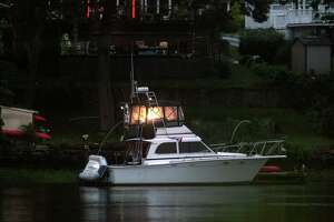 Boats are docked at a home along the Housatonic River in Stratford, Conn., on Friday July 10, 2020. A rare tropical storm named Fay started Friday evening hitting the area with winds from 35-45 mph and gusts up to 50 mph.