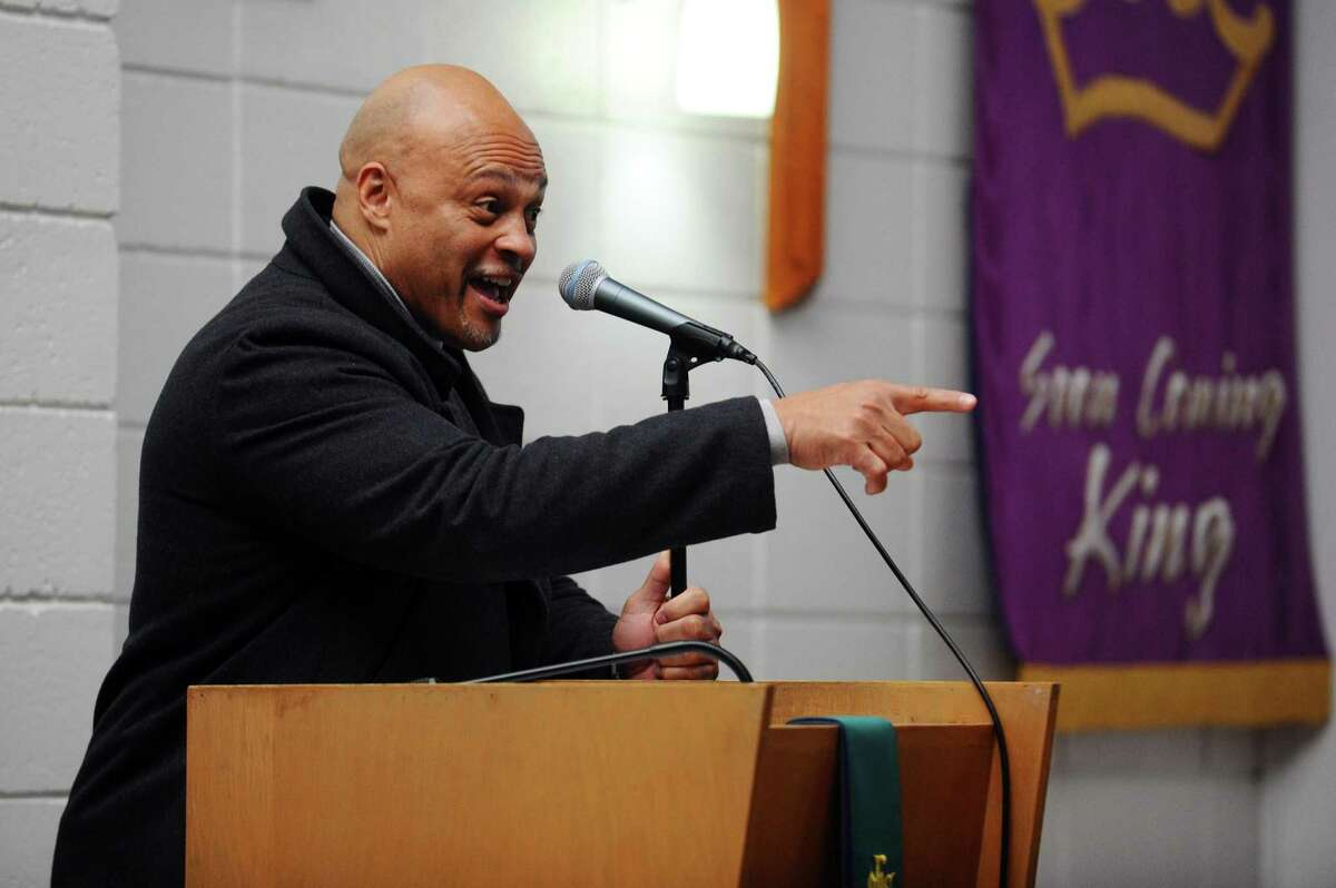 Guy Fortt, one of three grand marshals for the annual Martin Luther King Jr. Day march, speaks inside Bethel AME Church prior to walking through downtown Stamford, Conn. on Monday, Jan. 16, 2017.