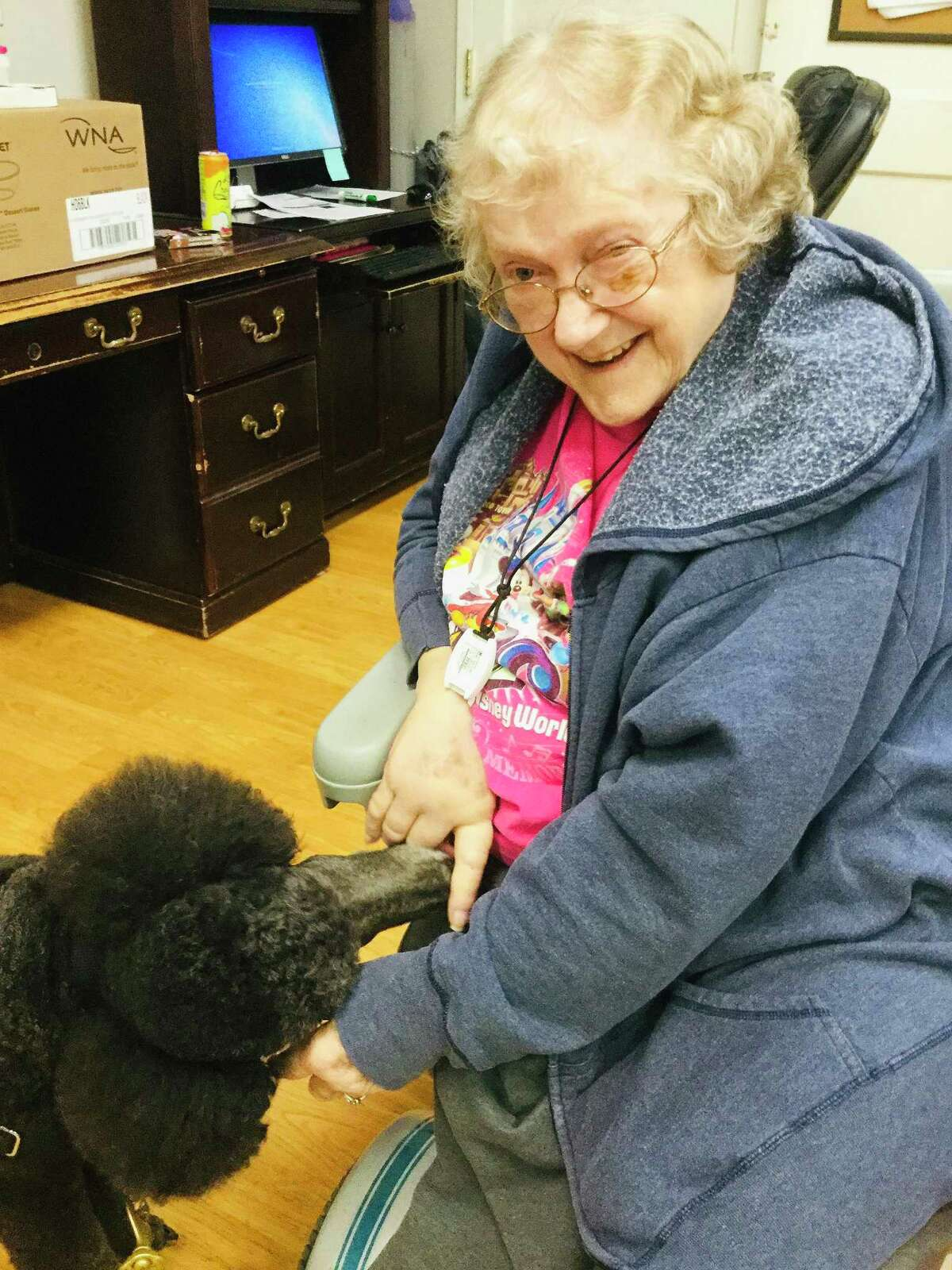 Camarena pays Miss Beverly a visit at one of the local nursing homes. The standard poodle is one of many pets in the Texas Therapy Pet Pals that brightens the day of residents.