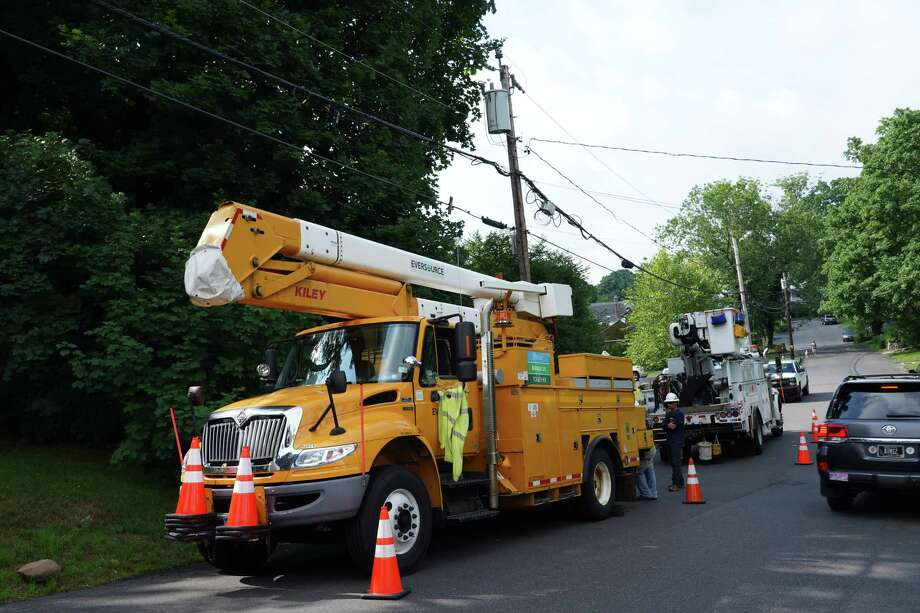 Eversource crews were recently out repairing wires in New Canaan, Saturday morning, July 11, 2020. The wires caught fire the night before, July 10, during Tropical Storm Fay. Power is now fully restored to all Eversource customers in the town after it was also out for 29 of the customers early Sunday morning, July 12, 2020, according to the region report, and outage map on the electric services company's website. The information follows the number of outages being at zero on Saturday, after the tropical storm. Photo: Grace Duffield / Hearst Connecticut Media