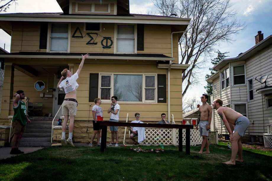 Students from the University of Northern Colorado play drinking games in front of their frat house in Greeley, Colo. Photo: Photo For The Washington Post By Chet Strange. / Chet Strange