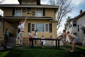 Students from the University of Northern Colorado play drinking games in front of their frat house in Greeley, Colo.
