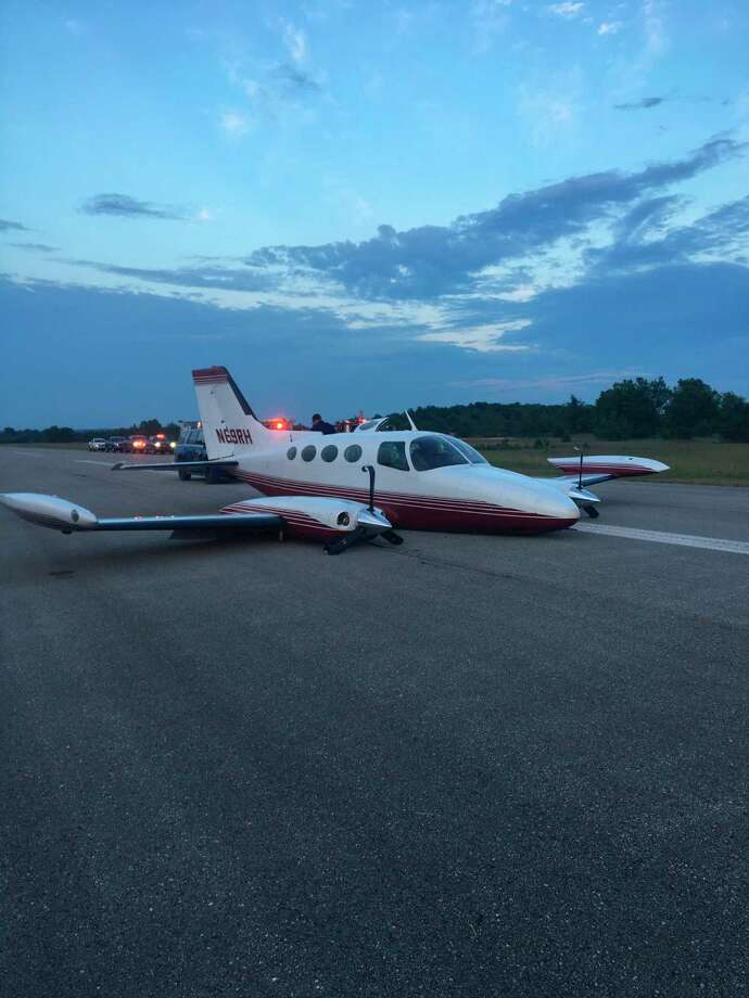 A Cessna twin engine came to a skidding halt at Thompsonville airport after the pilot forgot to put down landing gear, according to law enforcement. (Courtesy Photo)