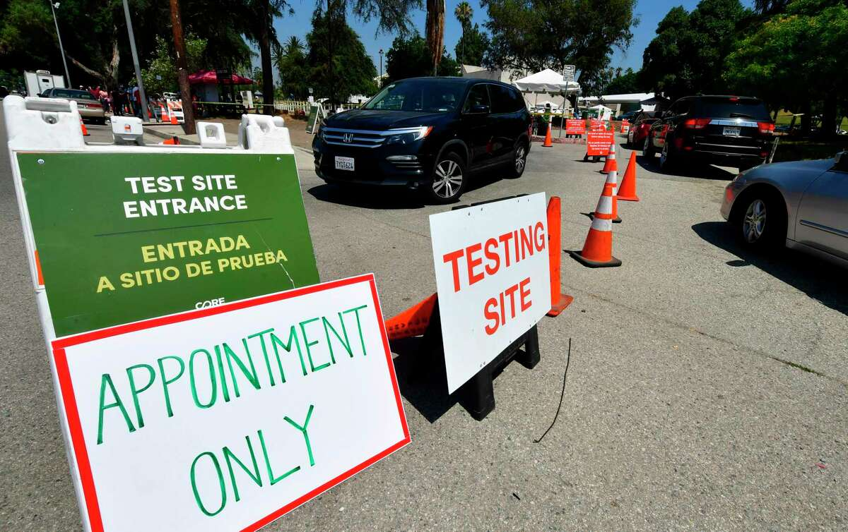 Vehicles arrive and depart a mobile COVID-19 test site in Los Angeles, California on July 10, 2020 as the state continues to set record-highs in coronavirus cases. (Photo by Frederic J. BROWN / AFP) (Photo by FREDERIC J. BROWN/AFP via Getty Images)