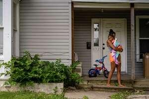 Fayden Johnson holds Mia Nuzum while at friend Zac Nuzum's home in Fort Dodge, Iowa, on July 3, 2020.