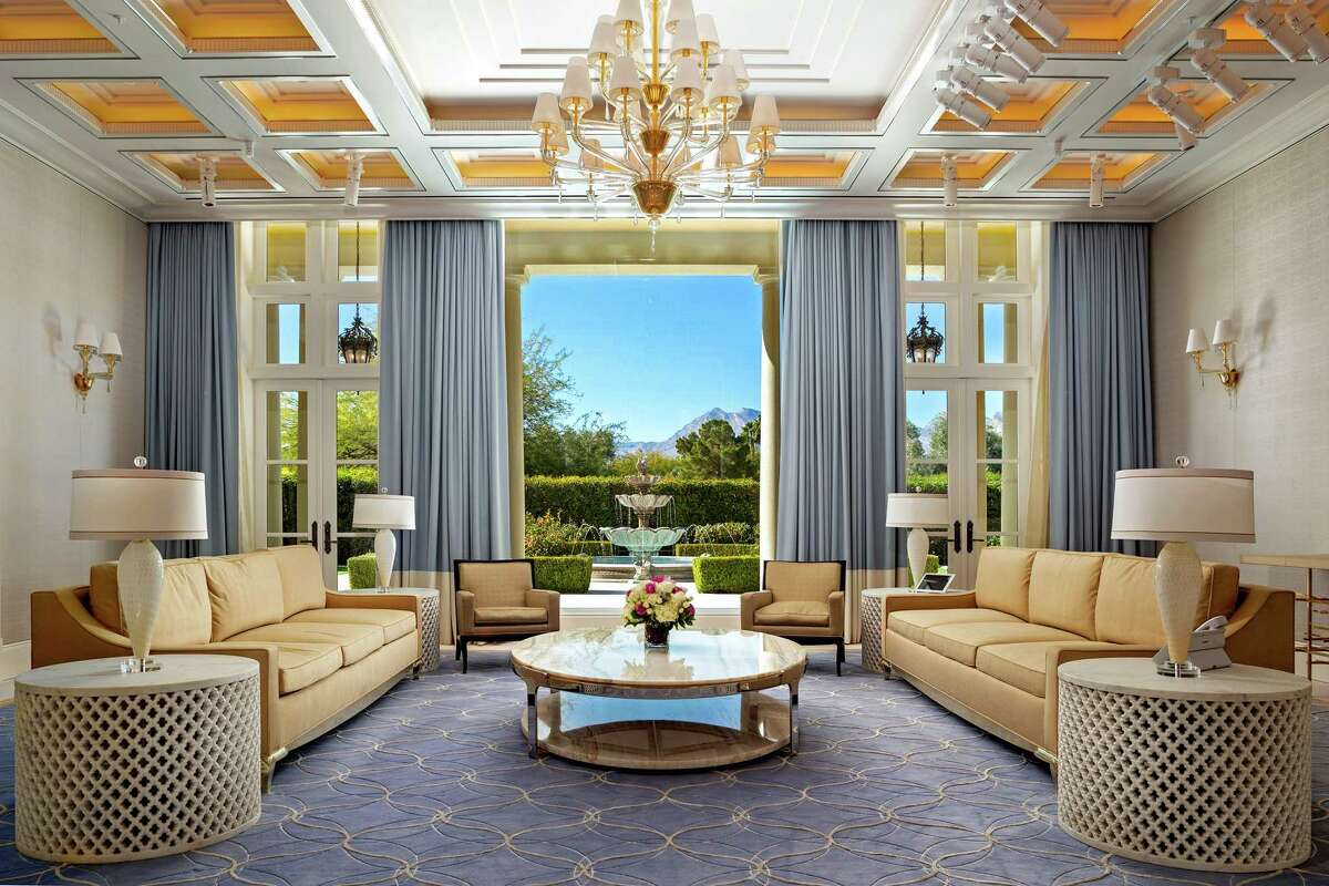 The Las Vegas mansion of casino mogul Steve Wynn underwent a $16-million renovation prior to hitting the market for $25 million. The Tuscan-inspired spread evokes the Wynn and Encore -- Wynn's casino -- with its patterned rugs and ornate ceiling details. Silk carpeting and fabric walls are among details found throughout. (Berkshire Hathaway HomeServices Nevada Properties/TNS)