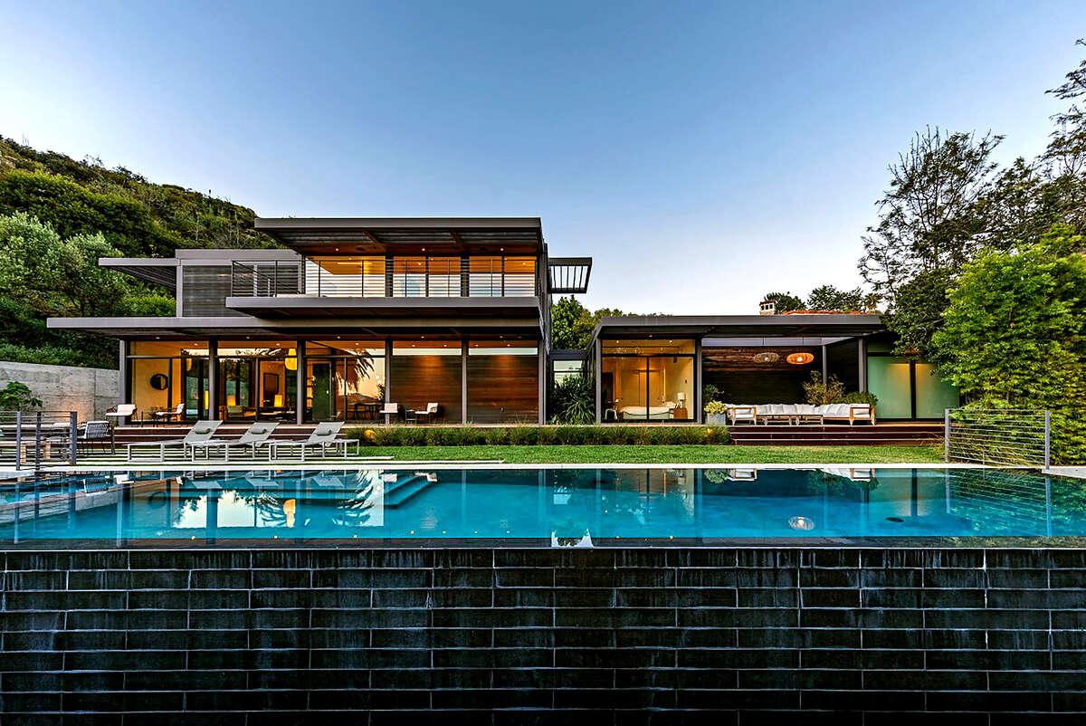 The West Los Angeles home of actor Will Arnett, listed for $10.995 million, is comprised of six modules that were built off-site and later assembled on location. Walls of glass, overhanging eaves and open-concept living spaces are among features of the home. Outside, there's tiered decking and a swimming pool. (Berlyn Photography/TNS)