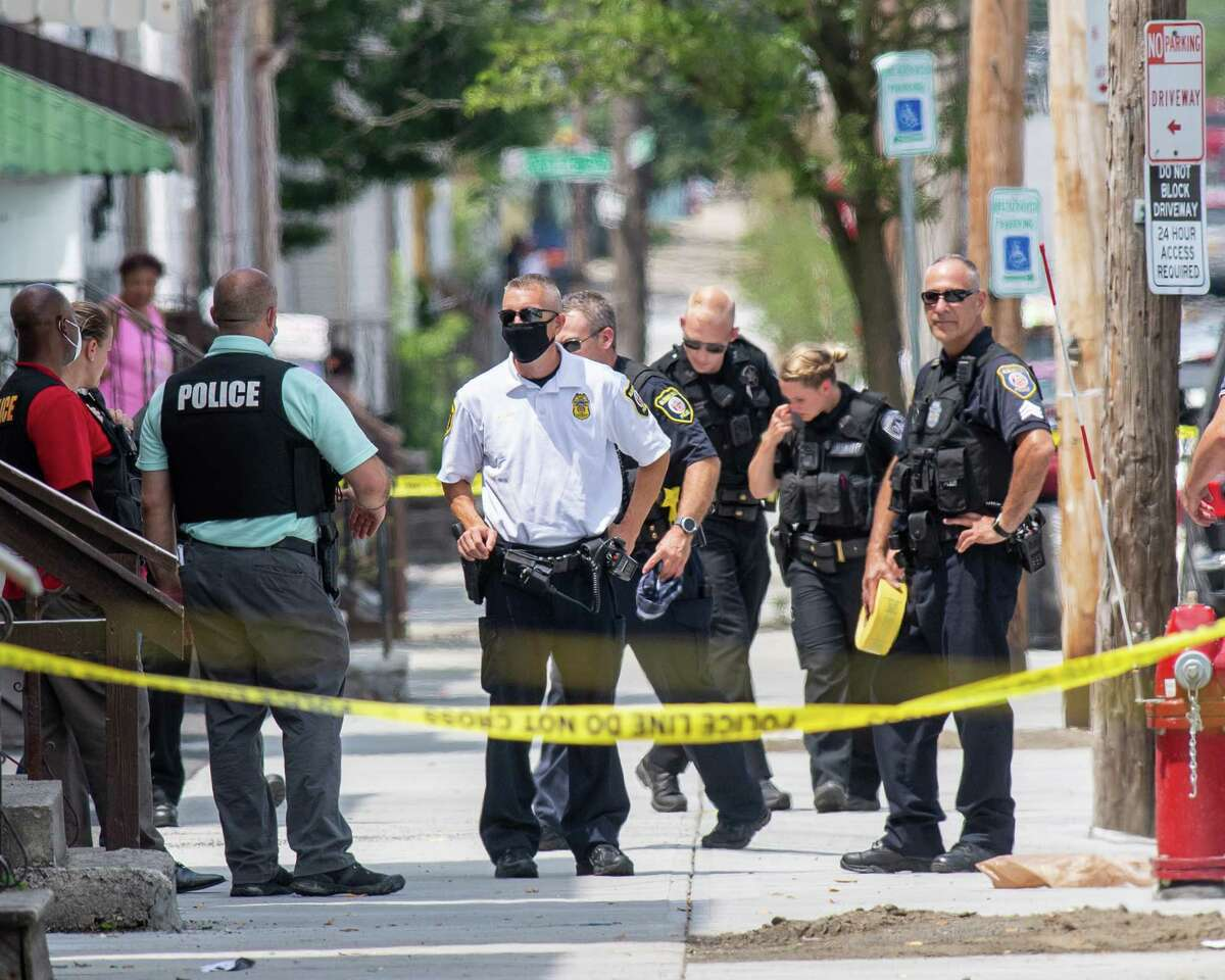 Albany police process the city's most recent shooting on Second Street on Saturday, July 11, 2020. According to police, an 18-year-old male was shot in the leg and taken to Albany Medical Center Hospital for treatment of non-life threatening injuries. (Jim Franco/special to the Times Union.)