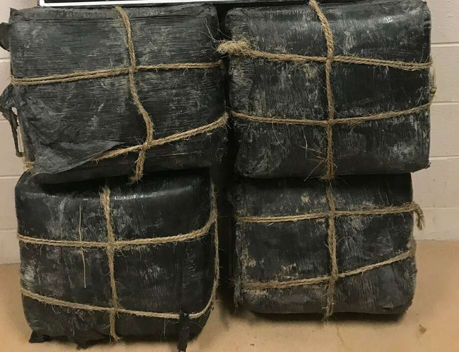 More than $150,000 in marijuana is pictured after it was recovered after a drug smuggler tried to pose as a golfer at the Max A. Mandel Golf Course. Photo: Courtesy