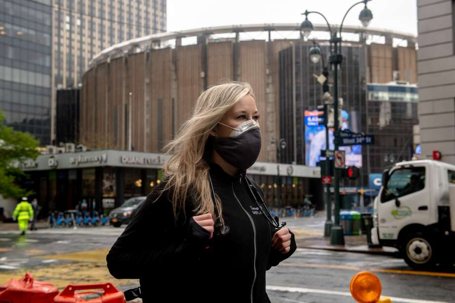 FILE -- Tamara Williams, a traveling nurse from Dallas, in Midtown Manhattan on April 24, 2020. Several times since returning from New York, she has run into acquaintances who have told her that they believe the coronavirus is no more than the flu. (Hilary Swift/The New York Times) Photo: HILARY SWIFT/NYT