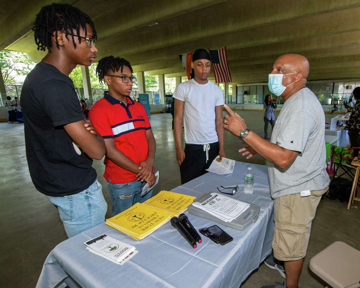 Andre Morris, of Trinity Alliance and Roots, talks about the importance of having a solid resume with Ziair Burden, OJ Jones and Kevin Brown during a Youth Job Fair sponsored by Albany SNUG and the Team Hittaz Boxing Club at the Swinburne Park ice skating rink on Clinton Avenue in Albany, NY, on Saturday, July 11, 2020 (Jim Franco/special to the Times Union.)