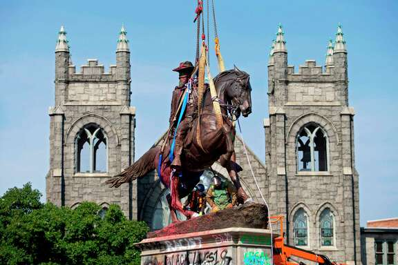 The statue of Confederate General J.E.B. Stuart is removed from Monument Avenue in Richmond, Virginia on July 7.  A reader thinks these statues should be left to stand in museums as reminders to Americans of how not to be.