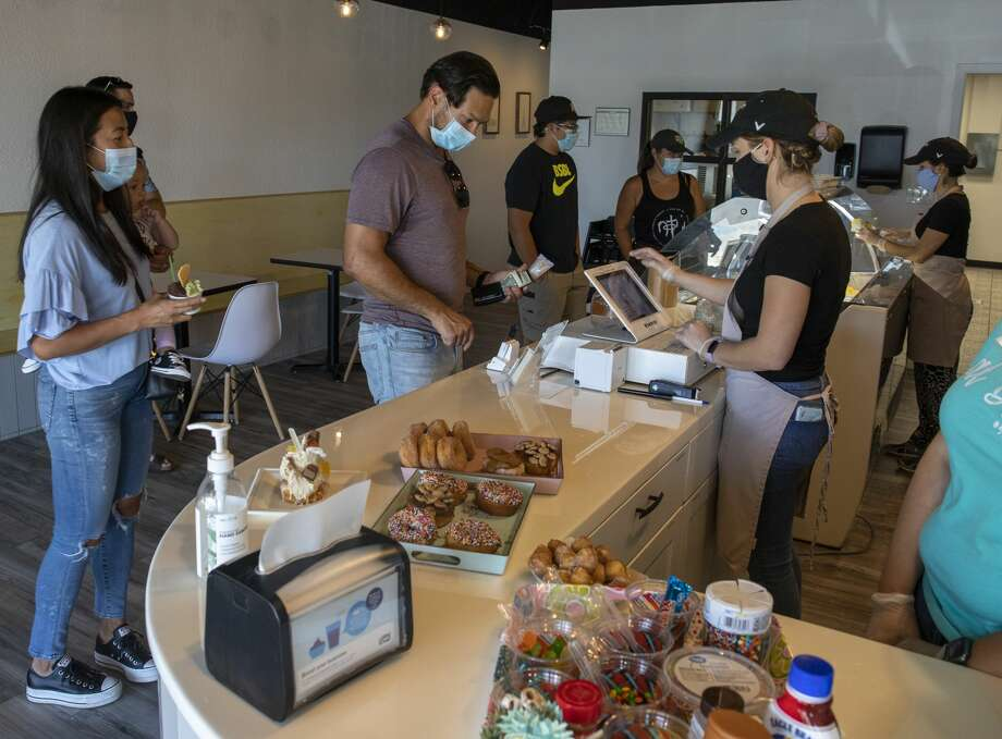 Customers enjoy a gelato and donut day on Saturday, July 11, 2020 as SisterDough collaborates with Amara Gelato at 3303 North Midkiff Road Suite 183. Photo: Jacy Lewis/Reporter-Telegram / Jacy Lewis/Reporter-Telegram