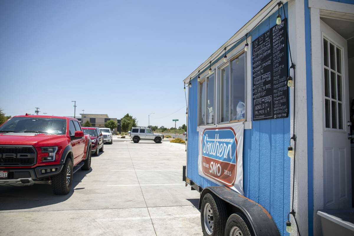 Midlanders drive through for snow cones Saturday, July 11, 2020 at Southern Sno set up in the YoungLife parking lot on Wadley Avenue.