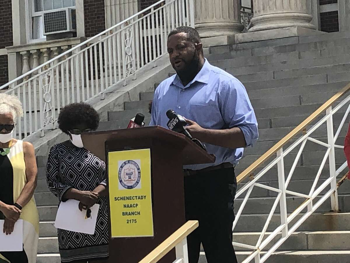Dr. Odo Butler, President of the Schenectady branch of the NAACP, addresses crowd at press conference at Schenectady city hall.