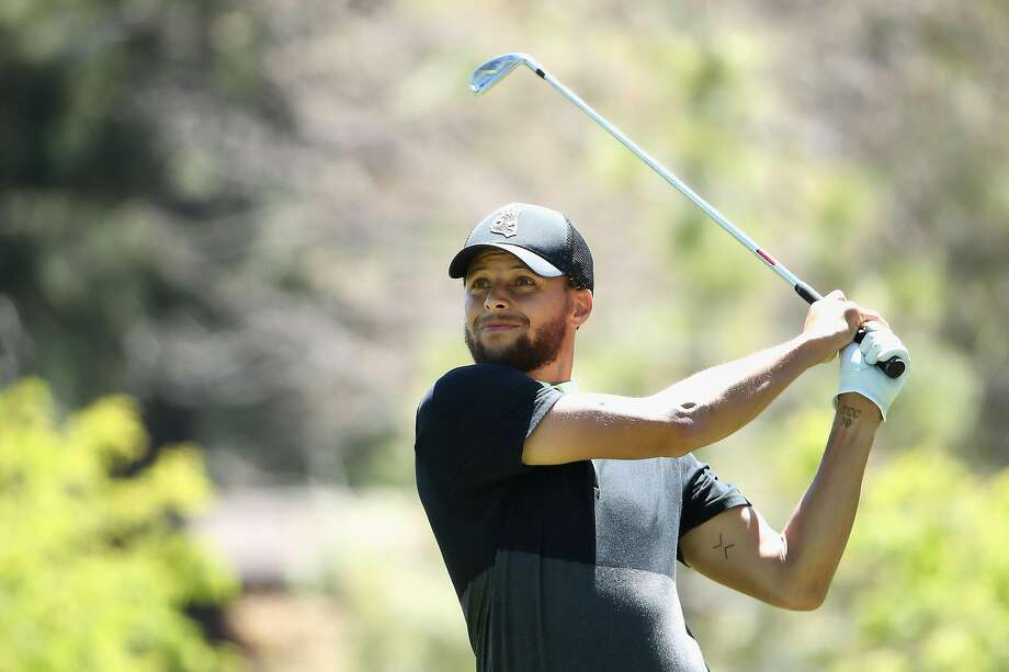 Stephen Curry plays a tee shot on the ninth hole during the second round at Lake Tahoe. The Warriors guard is in 11th place. Photo: Christian Petersen / Getty Images