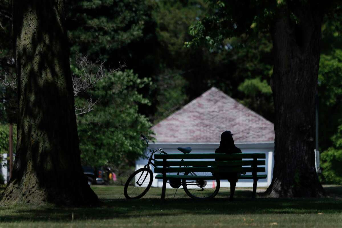 FILE - In this June 29, 2020 file photo, a cyclist sits on a Hoyt Park bench in Saginaw, Mich. It has been months since many people first learned what a shelter-in-place order even meant. As restrictions are slowly lifted, ita€™s now time to reflect. This is a meaningful opportunity to learn from what wea€™ve all experienced. Experts explore some of the financial repercussions of this pandemic, including what Americans have been learning in the process, and how theya€™ll likely apply these lessons to life after the outbreak is over. (AP Photo/Charles Rex Arbogast, File)