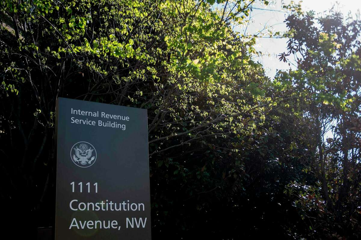 A sign for the Internal Revenue Service building is viewed in Washington, DC, on April 18, 2018. Americans are getting an extra day to file their taxes after key elements of the IRS website crashed on deadline day. / AFP PHOTO / JIM WATSONJIM WATSON/AFP/Getty Images