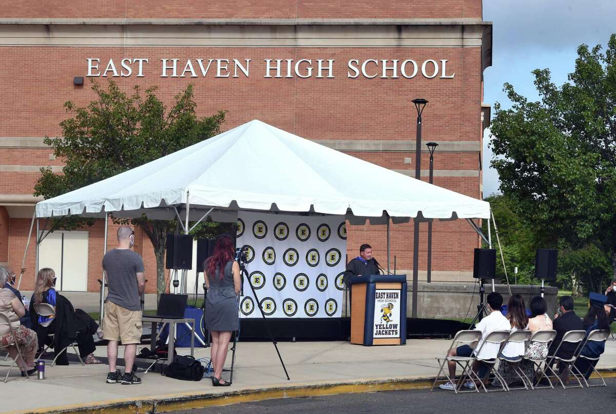 Principal Vincent DeNuzzo speaks at the East Haven High School graduation ceremony in front of the school on July 11, 2020.
