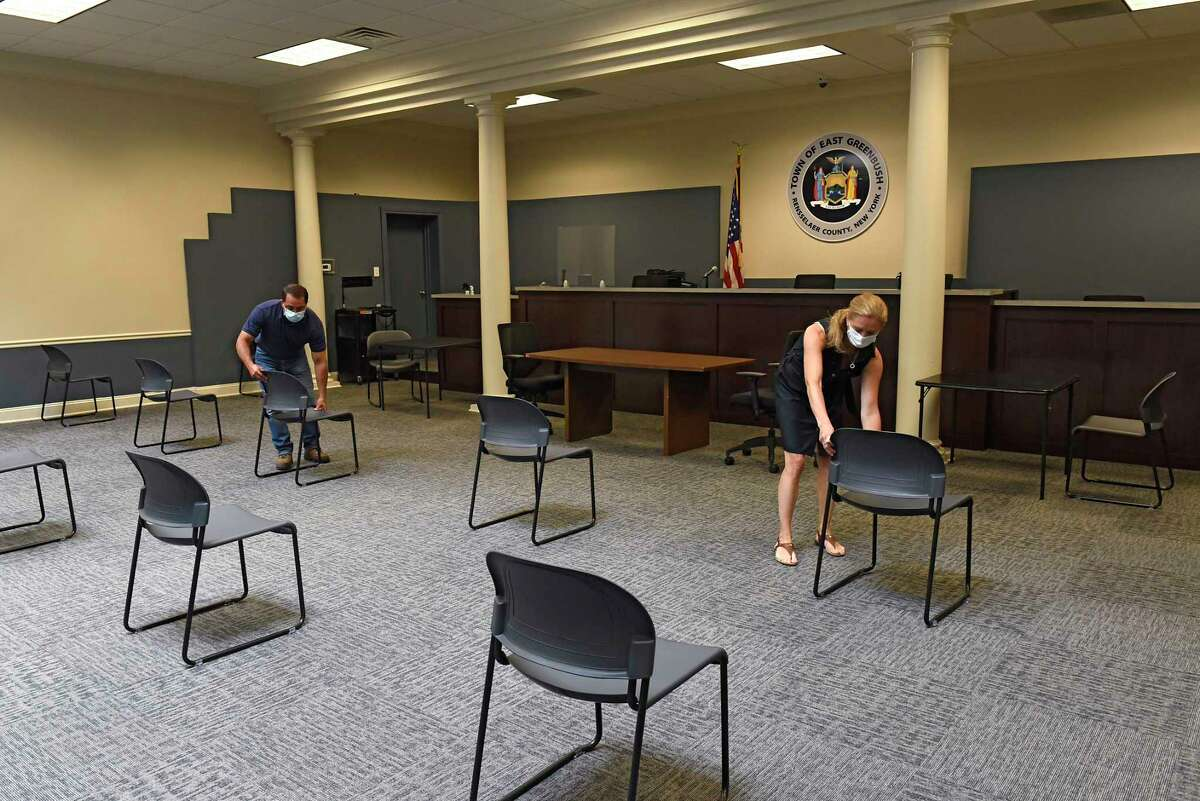 Commissioner of Public Works Dan Fiacco and Town Clerk Ellen Pangburn set up chairs in compliance to social distancing in the redesigned meeting room at the East Greenbush Town Hall on Friday July 10, 2020 in East Greenbush, N.Y. (Lori Van Buren/Times Union)