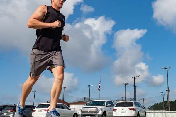 Kaleb Baker runs in the Team 10k Run fundraiser for Pour Brothers Brewery at Crossfit Bridge City during the early morning heat on Saturday morning. Photo made on July 11, 2020. Fran Ruchalski/The Enterprise