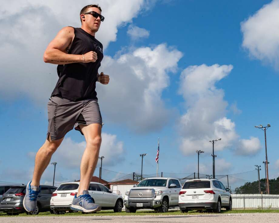 Kaleb Baker runs in the Team 10k Run fundraiser for Pour Brothers Brewery at Crossfit Bridge City during the early morning heat on Saturday morning. Photo made on July 11, 2020. Fran Ruchalski/The Enterprise Photo: Fran Ruchalski/The Enterprise / © 2020 The Beaumont Enterprise