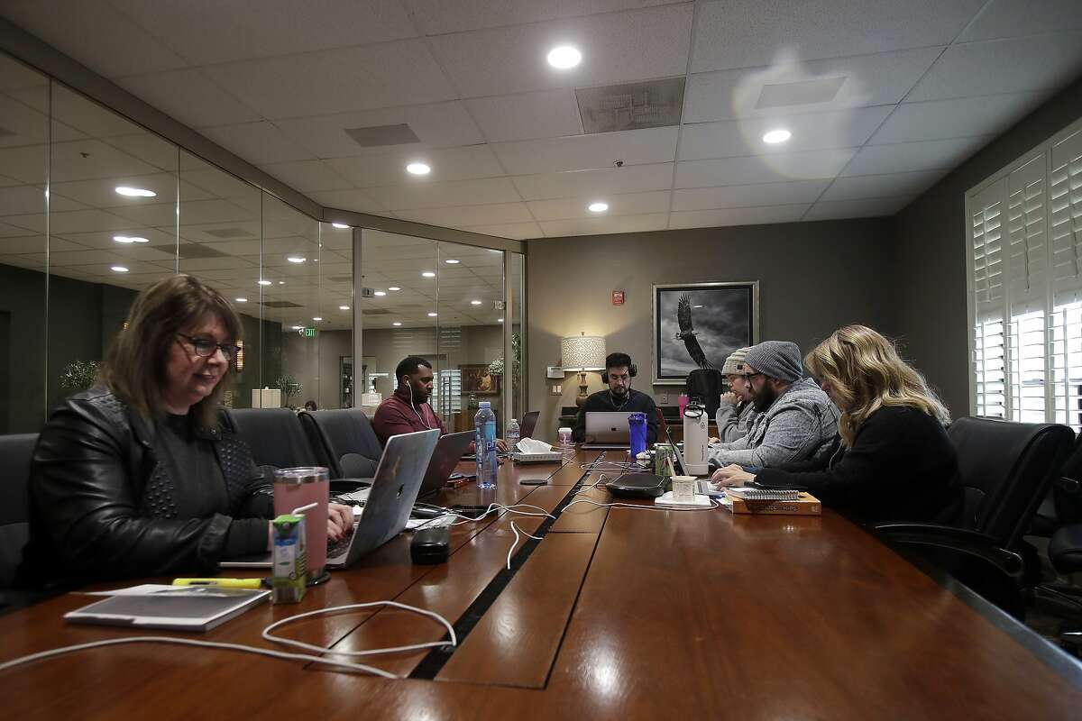 FILE - In this Sunday, March 15, 2020 file photo, the Bay Church online pastoral team works on their computers during an online church service in Concord, Calif. (AP Photo/Jeff Chiu)