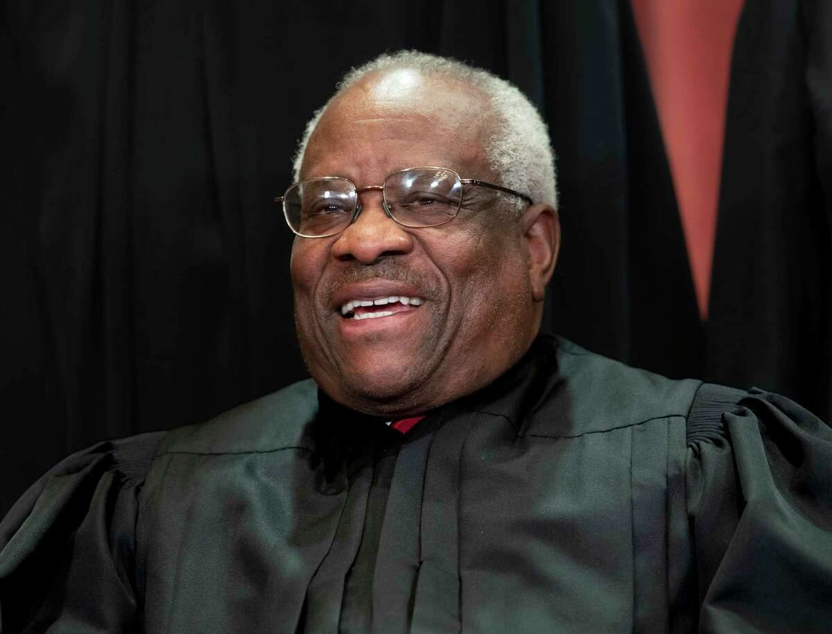 FIILE - In this Nov. 30, 2018, file photo, Supreme Court Associate Justice Clarence Thomas, appointed by President George H. W. Bush, sits with fellow Supreme Court justices for a group portrait at the Supreme Court Building in Washington. Thomas is now the longest-serving member of a court that has recently gotten more conservative, putting him in a unique and potentially powerful position, and hea€™s said he isna€™t going away anytime soon. With President Donald Trumpa€™s nominees Neil Gorsuch and Brett Kavanaugh now on the court, conservatives are firmly in control as the justices take on divisive issues such as abortion, gun control and LGBT rights. (AP Photo/J. Scott Applewhite, File)