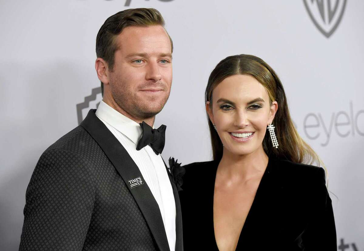 FILE - In this Jan. 7, 2018, file photo, Armie Hammer, left, and Elizabeth Chambers arrive at the InStyle and Warner Bros. Golden Globes afterparty in Beverly Hills, Calif. The actor, known for his work in