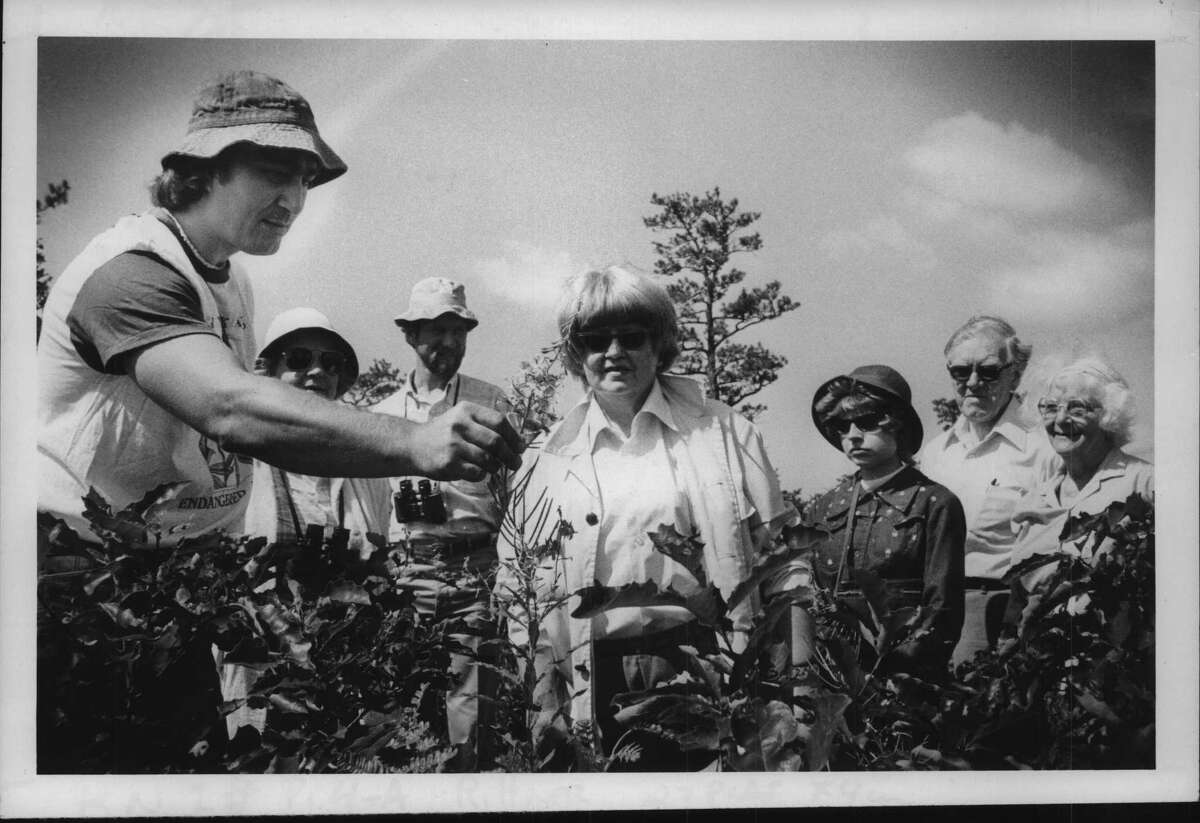 Pine Bush, Albany, New York - Don Rittner; Mrs. Helen A Knapp of Colonie Undated (center), and Sierra Club members, looking at a wild flower. July 12, 1980 (Bob Richey/Times Union Archive)