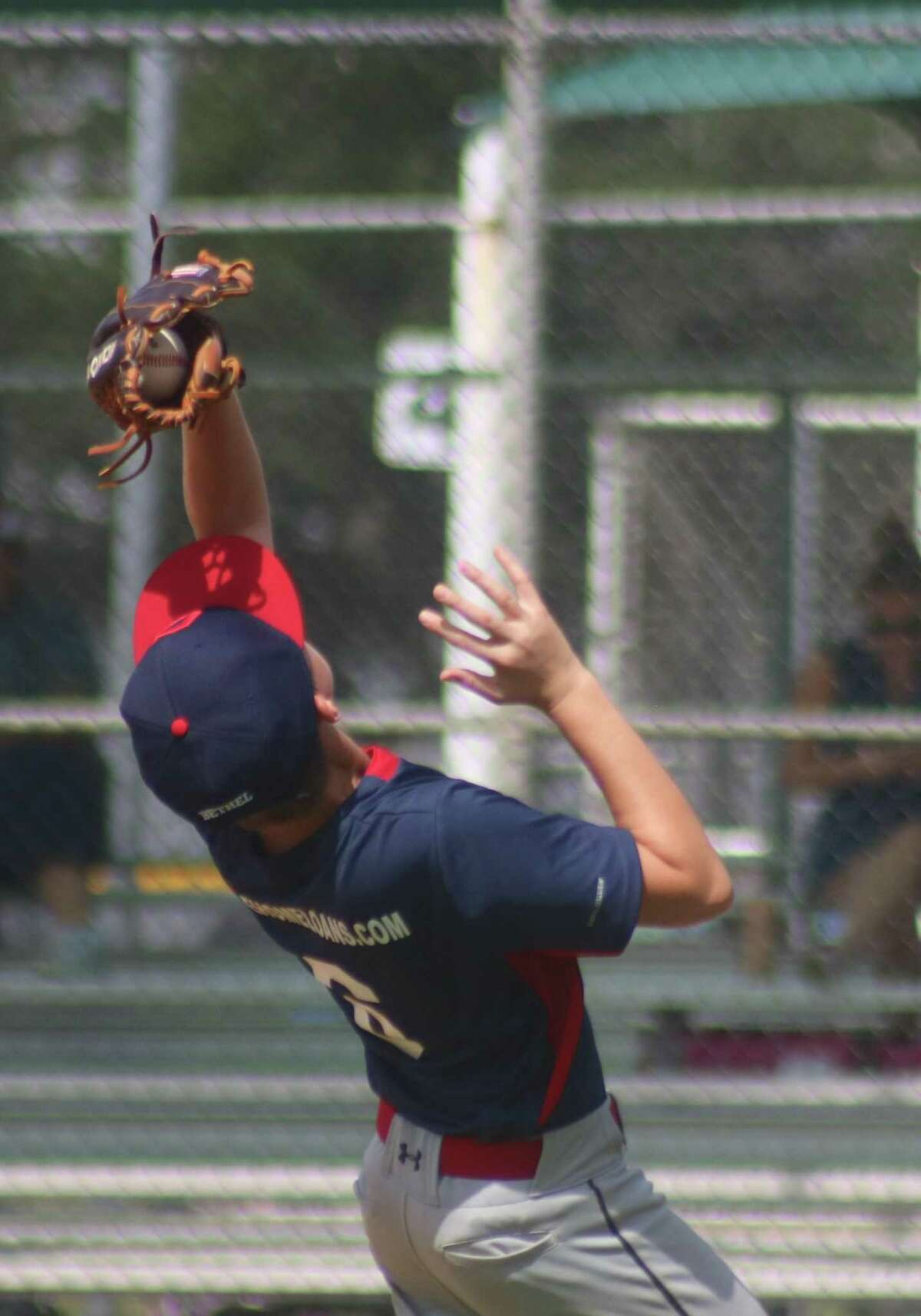 A Hayden Ford fly ball nestles in the glove of Indians third baseman Gordon Bethel during first-inning action Saturday morning.